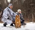 Myśliwy z synem i psem